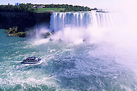 'Maid of the Mist' Boat Tour in the Niagara River at Niagara Falls (Canadian 'Horseshoe Falls'), in the City of Niagara Falls, Ontario, Canada - view across to Goat Island in Buffalo, New York, USA - Natural Wonder of the World