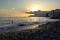 Tramonto alla spiaggia del paese Camogli (Liguria) --- Sunset on the beach at the village Camogli (Liguria)