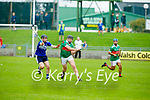 Crotta's Darragh Kennelly attempts to clear his defence as Padraig Kearney of St Brendan's attempts to block his effort in the County Senior Hurling Championship quarter final