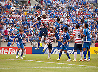 Eddie Johnson (26) of the United States heads in a goal during the quarterfinals of the CONCACAF Gold Cup at M&T Bank Stadium in Baltimore, MD.  The United States defeated El Salvador, 5-1.