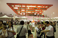 China. Shanghai. World Expo. Expo 2010 Shanghai China. View on the China Pavilion at night. Chinese tourists take pictures and enjoy the sunset. 27.06.10 © 2010 Didier Ruef