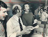 1979 FILE PHOTO - ARCHIVES -<br /> <br /> Clark; Joe (election campaign 1979) : <br /> <br /> Happy hour on Tory plane as Joe Clark leads a sing-song with Quebec reporter Pierre Gravelle.<br /> Bezant, Graham<br /> Picture, 1979<br /> <br /> 1979,<br /> <br /> PHOTO : Graham Bezant - Toronto Star Archives - AQP