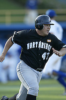 Randall Akasaka of the California State Northridge Matadors runs to first base during a game against the UCLA Bruins at Jackie Robinson Stadium on January 31, 2003 in Los Angeles, California. (Larry Goren/Four Seam Images)