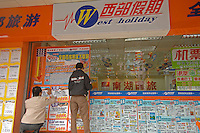Agents put up holiday destination posters at the West Holiday travel agency in Guangzhou, China. tourism i china has been on the increase in the last ten years with millions of tourists traveling internally and ever-increasing numbers venturing abroad, with France and the US being the most popular destinations..04 Jan 2007