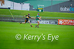 Crotta's Tomas O'Connor clears his lines despite the attempted block from Jack Lenihan of Dr Crokes in the Senior County Hurling championship, round 2 game.