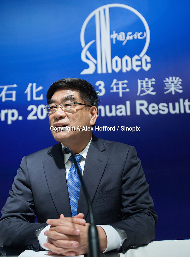 """China Petroleum & Chemical Corporation (Sinopec) Chairman Fu Chengyu is seen at a press conference to announce the company's annual financial results for the year ended 31 December 2013, Hong Kong, China, 24 March 2014. Sinopec, China's largest upstream refiner of oil and natural gas, announced that profits rose in 2013. The company said it recorded steady growth in 2013 despite sluggishness in the domestic and global economies. The company announced a profit attributable to equity shareholders of the company was CNY 66.1 billion (Euro 7.74 billion), up 3.5% year-on-year, with revenue up 3.4 per cent thanks to """"stable"""" domestic demand."""