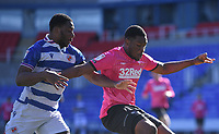 5th April 2021; Madejski Stadium, Reading, Berkshire, England; English Football League Championship Football, Reading versus Derby County;  Yakou Meite of Reading competes for the ball with Teden Mengi of Derby County