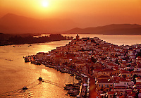 Sunrise view over capital and harbor Poros Saronic Islands Greece.