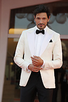 """VENICE, ITALY - SEPTEMBER 10: Andrés Velencoso on the red carpet for the movie """"Un Autre Monde"""" during the 78th Venice International Film Festival on September 10, 2021 in Venice, Italy.<br /> CAP/GOL<br /> ©GOL/Capital Pictures"""
