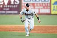 Birmingham Barons first baseman Gavin Sheets (24) charges towards home plate during the game against the Pensacola Blue Wahoos at Regions Field on July 7, 2019 in Birmingham, Alabama. The Barons defeated the Blue Wahoos 6-5 in 10 innings. (Brian Westerholt/Four Seam Images)