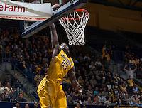Jabari Bird of California dunks the ball during 2014 National Invitation Tournament against Arkansas at Haas Pavilion in Berkeley, California on March 24th, 2014.  California defeated Arkansas, 75-64.
