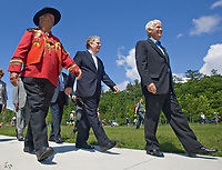 """Max """"One Onti"""" Gros-Louis, Grand-Chief of the Huron-Wendate nation (left), Quebec Premier Jean Charest, center, and Jacques Langlois, President and General Director of the Commission de la capitale Nationale, walk on the newly inaugurated Promenade Samuel-de-Champlain Tuesday June 24, 2008 in Quebec City. The Promenade, a 2.5km parkway along the St-Lawrence River, is the gift from the government of Quebec to Quebec city for her 400th's birthday<br /> <br /> PHOTO :  Francis Vachon - Agence Quebec Presse"""