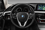 Car pictures of steering wheel view of a 2018 BMW 5 Series Touring Sport 5 Door Wagon
