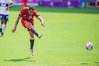 ORLANDO, FL - APRIL 24: Nick DeLeon #18 of Toronto FC kicks the ball during a game between Vancouver Whitecaps and Toronto FC at Exploria Stadium on April 24, 2021 in Orlando, Florida.