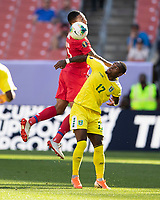 CLEVELAND, OH - JUNE 22: Eric Davis #15 goes up over Torell Ondaan #17 to head the ball during a game between Panama and Guyana at FirstEnergy Stadium on June 22, 2019 in Cleveland, Ohio.
