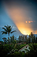 Sunset rays over residential Kapa'a, East Kaua'i.