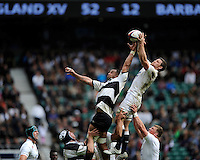 Mark Wilson of England outjumps Samu Manoa of Barbarians in the lineout during the match between England and Barbarians at Twickenham Stadium on Sunday 31st May 2015 (Photo by Rob Munro)