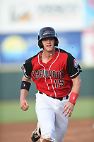 Josh Jung (15) of the Hickory Crawdads runs to third base during a game against the Kannapolis Intimidators at L.P. Frans Stadium on July 16, 2019 in Hickory, North Carolina. The Crawdads defeated the Intimidators 5-4. (Tracy Proffitt/Four Seam Images)
