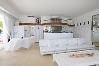 BNPS.co.uk (01202 558833)<br /> Pic: CapVillas/BNPS<br /> <br /> Living room<br />  <br /> A glamorous villa that has hosted a string of celebrities including Winston Churchill, Pablo Picasso, the Duke of Windsor and Edith Piaf is on the market for £9m (10.5m euros).<br /> <br /> The exquisite Villa La Garoupe Beach sits on a natural sand beach and has its own private beach on one of the French Riviera's most exclusive spots.<br /> <br /> It was once a renowned beach club and the list of names connected to the property are endless. French singer Edith Piaf hosted her engagement party to Theo Sarapo there and it was also visited by former US President Harry Truman, writer Ernest Hemingway, Bond actor Sean Connery and movie star Marlene Dietrich.<br /> <br /> The property in Cap d'Antibes has four bedrooms suitable for six to eight people, three bathrooms and a living area overlooking the sea.