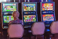 Las Vegas, Nevada.  Woman Playing Slot Machines, The Cromwell Casino.