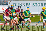Flor McCarthy, Kilmoyley in action against Colm Harty and Bryan Murphy , Causeway  during the Kerry County Senior Hurling Championship Final match between Kilmoyley and Causeway at Austin Stack Park in Tralee