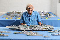 BNPS.co.uk (01202) 558833<br /> Pic: ZacharyCulpin/BNPS<br /> <br /> Pictured: Philip Warren with his brand new models the Gerald Ford US aircraft carrier (at the back centre), HMS Glasgow (third left) and HMS Trent (forth left).<br /> <br /> A master modeller who was inundated with hundreds of rare matchboxes after appealing for donations has used them to build a 3ft long aircraft carrier.<br /> <br /> Now Philip Warren has added the impressive model to his so-called matchbox fleet of miniature ships which have gone on display in an exhibition.<br /> <br /> Mr Warren's 72 year pastime of building model warships had looked as though it had come to an end earlier this year when he ran out of the traditional wooden boxes he used to make the hull and decks.<br /> <br /> But the 90-year-old was sent more than 300 of the lightweight matchboxes made from aspen wood in response to his plea for more.