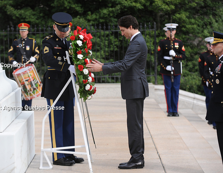 The Right Honorable Justin Trudeau, Prime Minister of Canada, lays a wreath at the Tomb of the Unknowns at Arlington National Cemetery, Arlington, Virginia in honor of the Prime Minister's official visit to the United States. The Official Host for the ceremony, Army Major General Bradley A. Belker, Commanding General, Military District of Washington accompanies the Prime Minister for the ceremony. (Department of Defense photo by Marvin Lynchard)