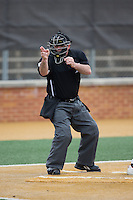 Home plate umpire Michael Cerra makes a strike call during the ACC baseball game between the Clemson Tigers and the Wake Forest Demon Deacons at David F. Couch Ballpark on March 12, 2016 in Winston-Salem, North Carolina.  The Tigers defeated the Demon Deacons 6-5.  (Brian Westerholt/Four Seam Images)