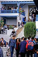 Tunisia, Sidi Bou Said.  Friday Evening Street Scene, in front of the Cafe des Nattes.