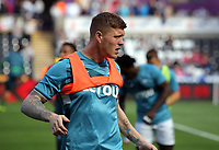 Alfie Mawson of Swansea City warms up during the Premier League match between Swansea City and Watford at The Liberty Stadium, Swansea, Wales, UK. Saturday 23 September 2017