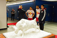 New York Red Bulls head coach Hans Backe talks with Tim Cahill (17) and Thierry Henry (14) during a snow delay  prior to playing D. C. United during the second leg of the MLS Eastern Conference Semifinals at Red Bull Arena in Harrison, NJ, on November 7, 2012.