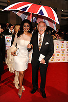 Bruce Forsyth and wife, Wilnelia dies at 89 retro set - <br /> arrives for the Pride of Britain Awards 2012 at the Grosvenor House Hotel, London<br /> <br /> ©Ash Knotek  D2537 29/10/2012