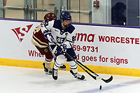 WORCESTER, MA - JANUARY 16: Antonia Matzka #23 of Holy Cross brings the puck forward during a game between Boston College and Holy Cross at Hart Center Rink on January 16, 2021 in Worcester, Massachusetts.