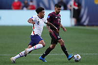 6th June 2021. Denver, Colorado, USA;  United States midfielder Weston McKennie challenges Mexico forward Jesus Corona during the CONCACAF Nations League finals between Mexico and the United States  at Empower Field at Mile High in Denver, CO.