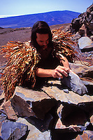 Stone artist Tom Piko chips basalt at Keanakakoi Quarry, an ancient adz quarry on Mauna Kea. This quarry is the largest and most remote in the world.
