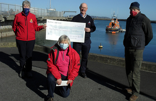 The presentation of a cheque for €4,500 to the RNLI was made by Jill Fleming, Derek Jago and Gillian Fletcher on behalf of the Dun Laoghaire Harbour Squib Fleet