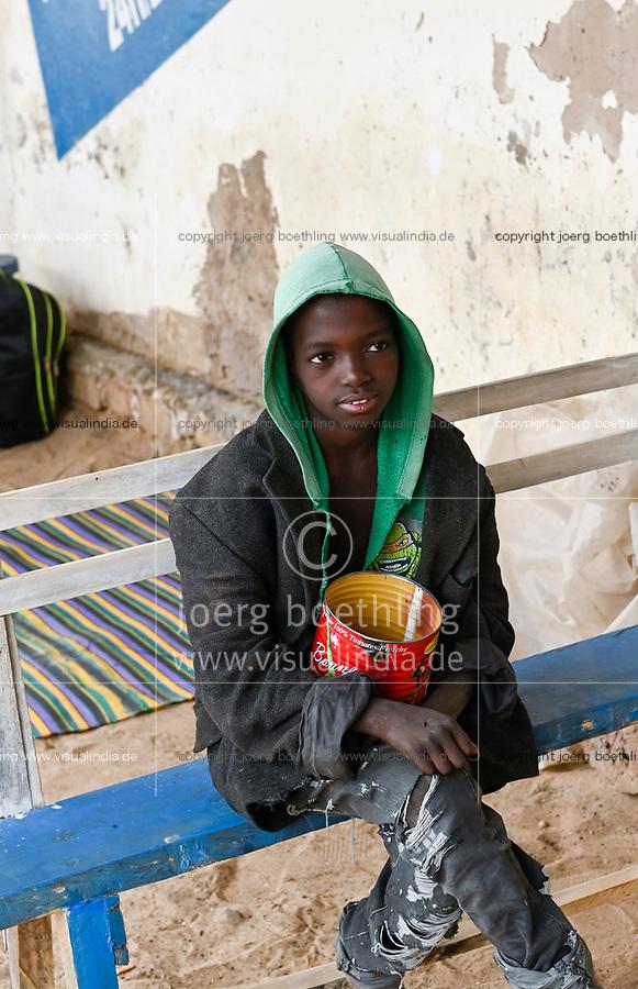 MALI, Kayes, Talibé boys, children belong to a quranic school daara beg with tomato tin can for their islamic teacher /  junge Koranschueler einer Koranschule betteln fuer ihren Marabout, islamischen Lehrer