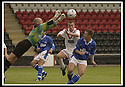 17/8/02               Copyright Pic : James Stewart                     .File Name : stewart-airdrie v stranraer 04.STRANRAER KEEPER CHRIS HILLCOAT PUNCHES THE BALL AWAY FROM AIRDRIE'S PAUL RONALD.....James Stewart Photo Agency, 19 Carronlea Drive, Falkirk. FK2 8DN      Vat Reg No. 607 6932 25.Office : +44 (0)1324 570906     .Mobile : + 44 (0)7721 416997.Fax     :  +44 (0)1324 570906.E-mail : jim@jspa.co.uk.If you require further information then contact Jim Stewart on any of the numbers above.........