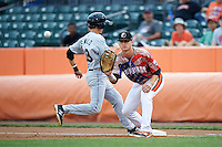 Aberdeen Ironbirds first baseman Steve Laurino (56) waits for a throw sa Johnny Sewald (33) gets back to the bag during a game against the Tri-City ValleyCats on August 6, 2015 at Ripken Stadium in Aberdeen, Maryland.  Tri-City defeated Aberdeen 5-0 in a combined no-hitter.  (Mike Janes/Four Seam Images)