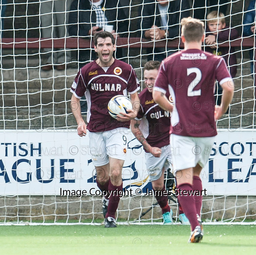 Stenny's Martin Grehan (9) celebrates after he scores their first goal.