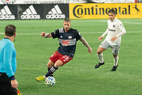 FOXBOROUGH, MA - NOVEMBER 1: Alexander Buttner #28 of New England Revolution turns as Yamil Asad comes in to tackle during a game between D.C. United and New England Revolution at Gillette Stadium on November 1, 2020 in Foxborough, Massachusetts.