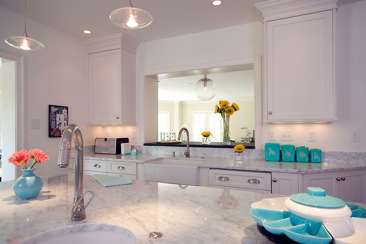 Modern White Kitchen with Turquoise Accents.