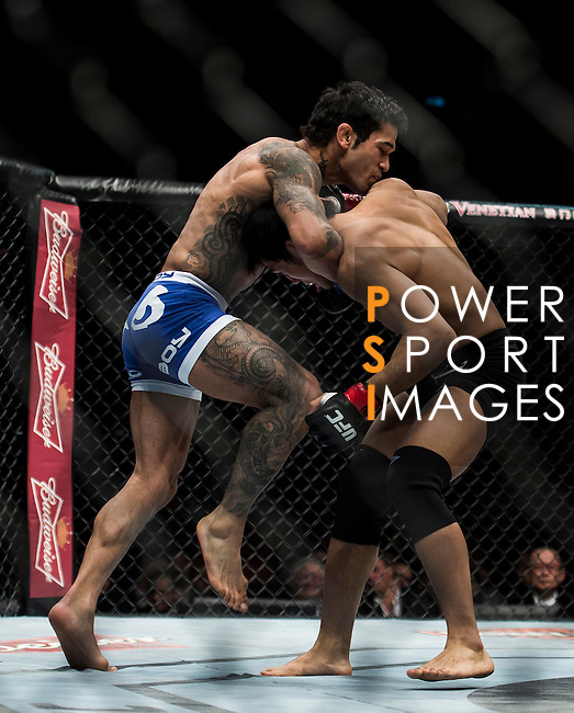 Nam Phan of Vietnam and Vaughan Lee of England fight on their Bantamweight Bout 3 Rounds during the UFC Fight Night at the Cotai Arena on 01 March 2014 in Macau, China. Photo by Victor Fraile / Power Sport Images