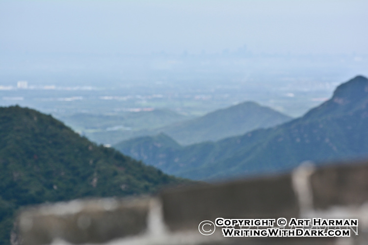 A stunningly-rare view of the Beijing skyline from the Great Wall. It rained overnight, which cleared the infamous pollution, offering this view.