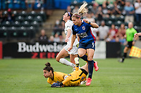 TACOMA, WA - JULY 31: Eugenie Le Sommer #9 of the OL Reign scores a goal and collides with Michelle Betos #1 of Racing Louisville FC during a game between Racing Louisville FC and OL Reign at Cheney Stadium on July 31, 2021 in Tacoma, Washington.