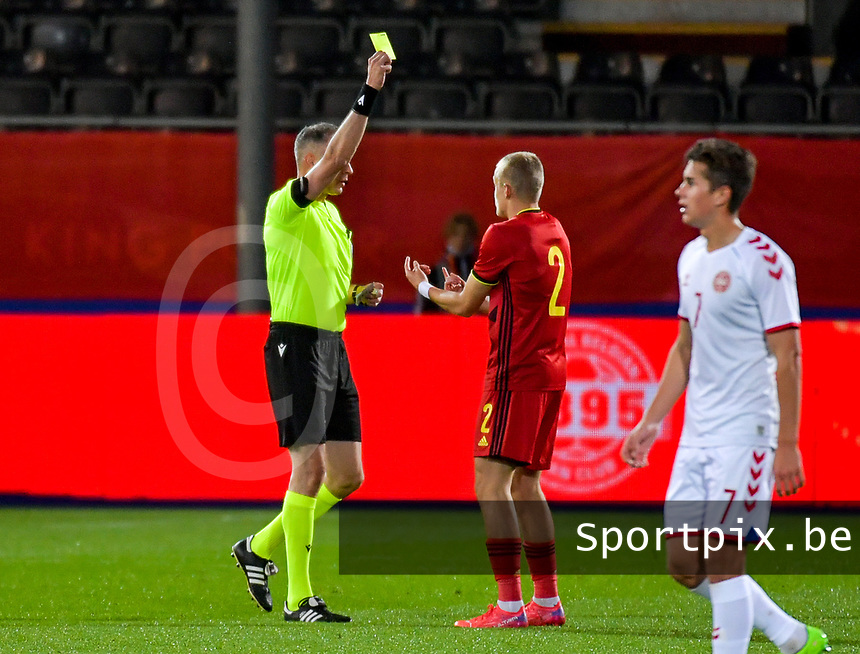 Match referee Tzilos Athanasios gives a yellow card to Hugo Siquet (2) of Belgium during a soccer game between the national teams Under21 Youth teams of Belgium and Denmark on the fourth matday in group I for the qualification for the Under 21 EURO 2023 , on tuesday 12 th of october 2021  in Leuven , Belgium . PHOTO SPORTPIX | STIJN AUDOOREN