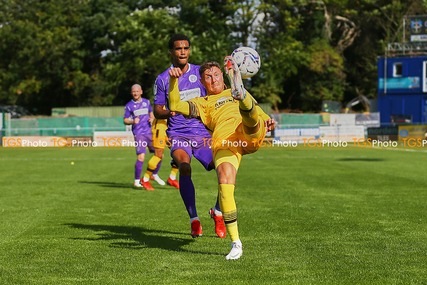 Richie Bennett of Sutton United and Terence Vancooten of Stevenage during Sutton United vs Stevenage, Sky Bet EFL League 2 Football at the VBS Community Stadium on 11th September 2021