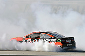 2017 Monster Energy NASCAR Cup Series - Kobalt 400<br /> Las Vegas Motor Speedway - Las Vegas, NV USA<br /> Sunday 12 March 2017<br /> Martin Truex Jr, Bass Pro Shops/TRACKER BOATS Toyota Camry celebrates his win with a burnout<br /> World Copyright: Nigel Kinrade/LAT Images<br /> ref: Digital Image 17LAS1nk07779
