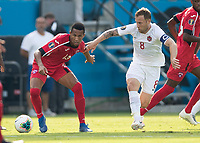 CHARLOTTE, NC - JUNE 23: Anibal Alvarez #13 makes a move while Scott Arfield #8 defends during a game between Cuba and Canada at Bank of America Stadium on June 23, 2019 in Charlotte, North Carolina.