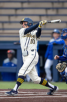 Michigan Wolverines third baseman Blake Nelson (10) follows through on his swing against the Indiana State Sycamores on April 10, 2019 in the NCAA baseball game at Ray Fisher Stadium in Ann Arbor, Michigan. Michigan defeated Indiana State 6-4. (Andrew Woolley/Four Seam Images)